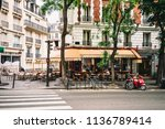 cozy street with tables of cafe ... | Shutterstock . vector #1136789414