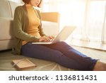 female freelancer sitting on... | Shutterstock . vector #1136811431