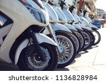 row of scooters for sale and... | Shutterstock . vector #1136828984