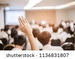 businessman raising hand... | Shutterstock . vector #1136831807