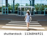 back rear view of young smiling ... | Shutterstock . vector #1136846921