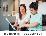 little boy and his mother are... | Shutterstock . vector #1136854604