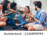 group of young friends playing...   Shutterstock . vector #1136890994