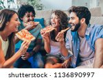 group of young friends eating... | Shutterstock . vector #1136890997