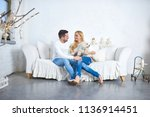 a beautiful happy young couple... | Shutterstock . vector #1136914451