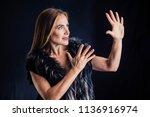 woman or actress in black dress ... | Shutterstock . vector #1136916974