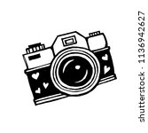 camera with lens decorated with ... | Shutterstock .eps vector #1136942627