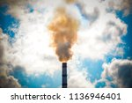 top tube factory with smoke... | Shutterstock . vector #1136946401