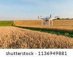 drone quad copter on yellow... | Shutterstock . vector #1136949881