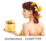 Girl with  autumn hairstyle  holding gift box. - stock photo