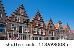 row typical dutch houses with... | Shutterstock . vector #1136980085