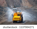 heavy truck pours the road with ... | Shutterstock . vector #1137004271