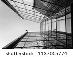 looking up a glass building in... | Shutterstock . vector #1137005774
