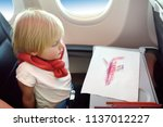charming kid traveling by an... | Shutterstock . vector #1137012227