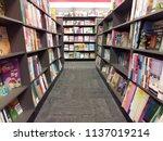 Small photo of petaling jaya, selangor, Malaysia - 18 July 2018 : stack of books on bookshelf inside the popular bookstore located in Paradigm Mall, Petaling Jaya, Selangor, Malaysia