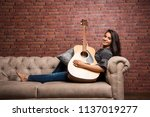 attractive indian asian young... | Shutterstock . vector #1137019277