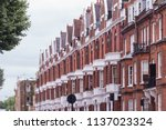 a row of typical london red... | Shutterstock . vector #1137023324