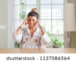 young woman at home covering... | Shutterstock . vector #1137086564