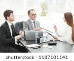 manager discussing work issues... | Shutterstock . vector #1137101141