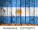 wooden background with a flag... | Shutterstock . vector #1137104771