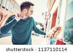 beautiful young couple enjoying ... | Shutterstock . vector #1137110114
