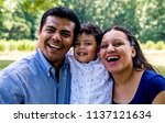 latino parents with their son ... | Shutterstock . vector #1137121634