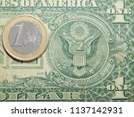 coin 1 euro against a paper... | Shutterstock . vector #1137142931