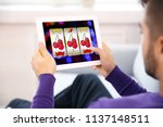 man using tablet for playing... | Shutterstock . vector #1137148511