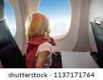 charming kid traveling by an... | Shutterstock . vector #1137171764