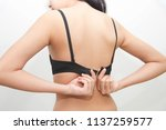woman back hand taking off or... | Shutterstock . vector #1137259577