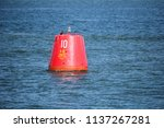 red beacon buoy with speed... | Shutterstock . vector #1137267281
