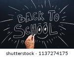 back to school written on... | Shutterstock . vector #1137274175