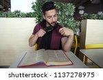 smart young man looking through ... | Shutterstock . vector #1137278975