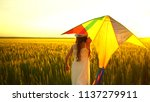 girl running around with a kite ...   Shutterstock . vector #1137279911