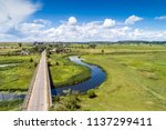 aerial view of windy river ... | Shutterstock . vector #1137299411