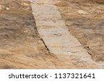 a concrete road built on a... | Shutterstock . vector #1137321641