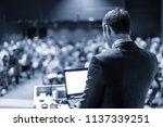 speaker giving a talk on... | Shutterstock . vector #1137339251