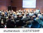 speaker giving a talk at... | Shutterstock . vector #1137373349