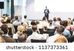 speaker giving a talk in... | Shutterstock . vector #1137373361