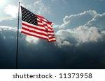american flag flies before a... | Shutterstock . vector #11373958