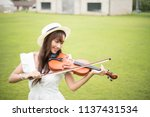 young beautiful woman violin... | Shutterstock . vector #1137431534