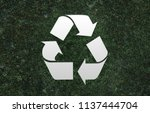 recycle sign grass background | Shutterstock . vector #1137444704