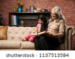 Small photo of Happy moments with grandma, indian/asian senior lady spending quality time with her grand daughter