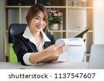 portrait of busy secretary... | Shutterstock . vector #1137547607