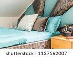 interior of  bedroom in loft... | Shutterstock . vector #1137562007