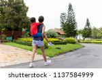 mother and son piggyback in the ... | Shutterstock . vector #1137584999