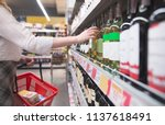 woman's hand takes a bottle of... | Shutterstock . vector #1137618491
