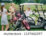 female golf players in caps at... | Shutterstock . vector #1137662297