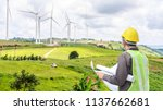 engineer worker at wind turbine ... | Shutterstock . vector #1137662681