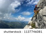 young man climbing on a rock in ... | Shutterstock . vector #1137746081